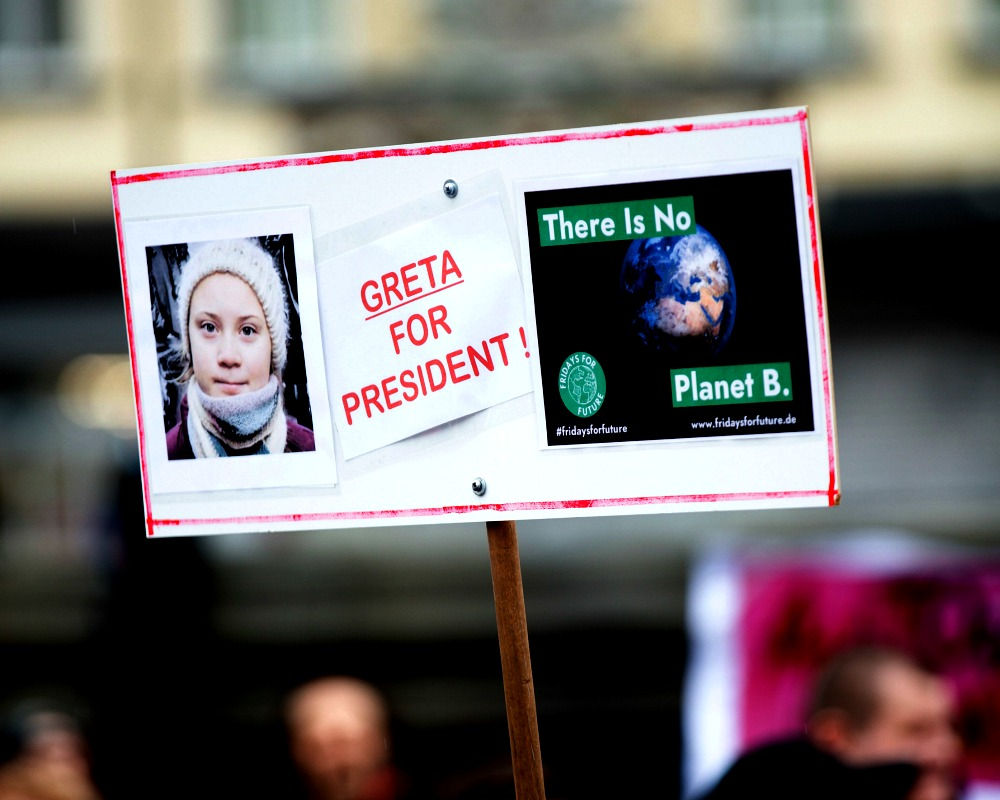 Climate change charities Greta for President sign CREDIT Markus Spiske-Unsplash 5_picmonkeyed